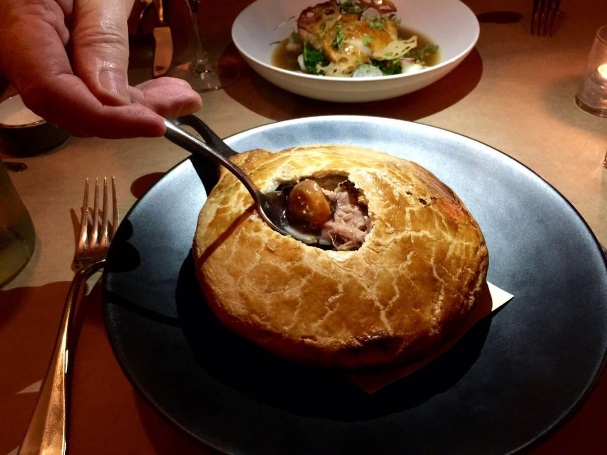 Hillside Supper Club: A rich pastry crust holds a rich gravy, carrots, potatoes and rabbit. Currently there's a vension pot pie on the menu ($24).