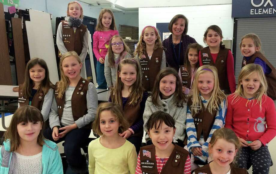 Second-graders in Ox Ridge Brownie Troop 50629 with Ox Ridge School nurse Barbara Spielman, who recently helped the girls earn their First Aid Badges. Photo: Contributed Photo / Darien News