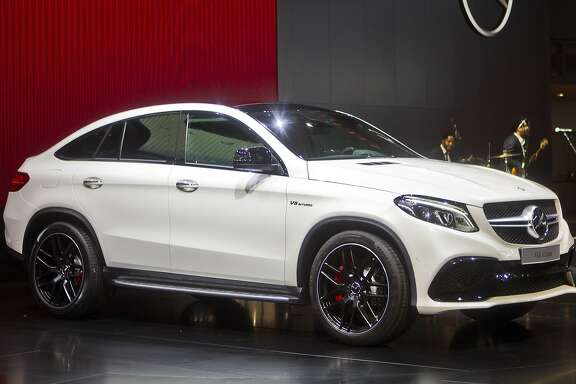 The new Mercedes GLE Coupe SUV is unveiled at the North American International Auto Show, Monday, Jan. 12, 2015, in Detroit. (AP Photo/Tony Ding)