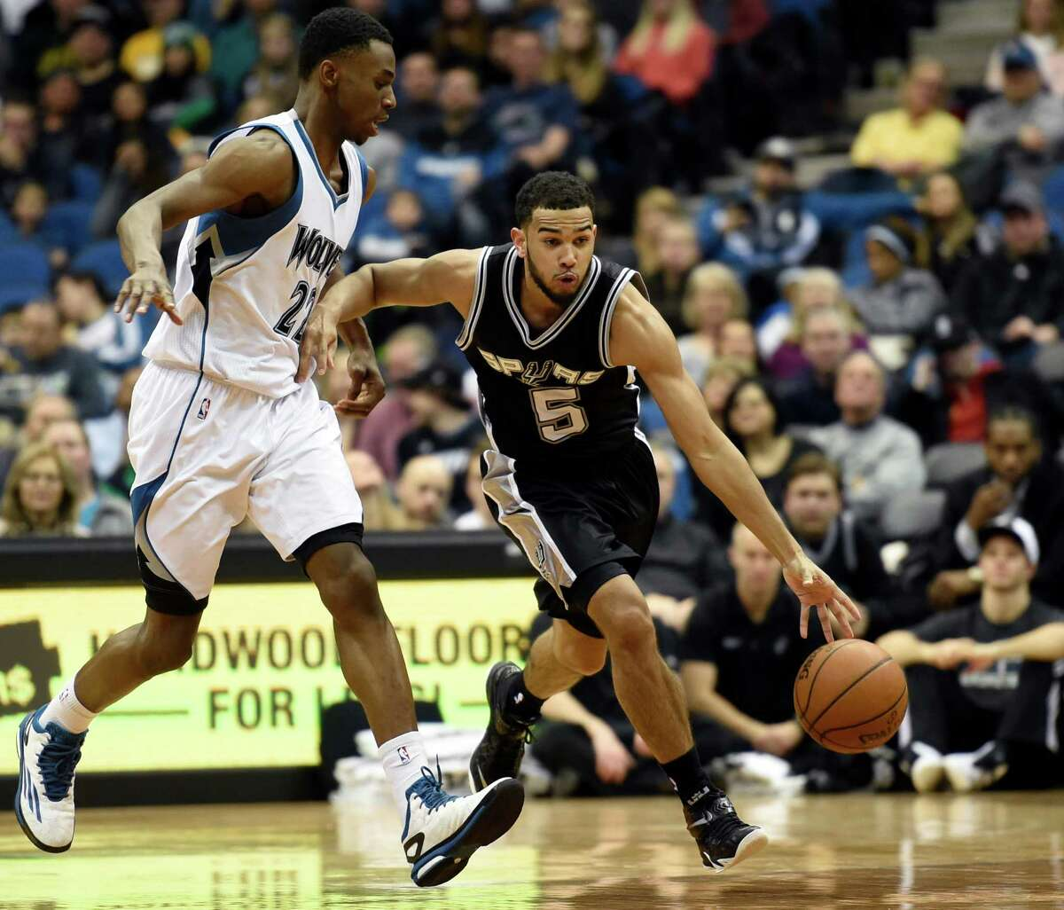 Minnesota Timberwolves forward Andrew Wiggins (left) defends San Antonio Spurs guard Cory Joseph (5) during the second quarter of an NBA basketball game Saturday, Jan. 10, 2015, in Minneapolis.