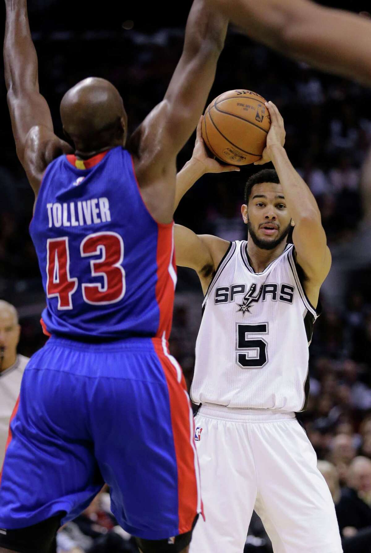 San Antonio Spurs' Cory Joseph (5) is defended by Detroit Pistons' Anthony Tolliver (43) during the second half of an NBA basketball game, Tuesday, Jan. 6, 2015, in San Antonio. Detroit won 105-104. (AP Photo/Eric Gay)