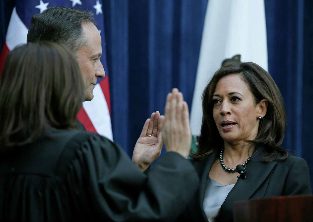 California Attorney General Kamala Harris, right, takes the oath of office last week from California Supreme Court Chief Justice Tani Cantil-Sakauye, left, as her husband, Douglas Emhoff, looks on at the Crocker Art Museum in Sacramento, Calif. Harris announced Tuesday that she will seek the U.S. Senate seat being vacated by Sen. Barbara Boxer.