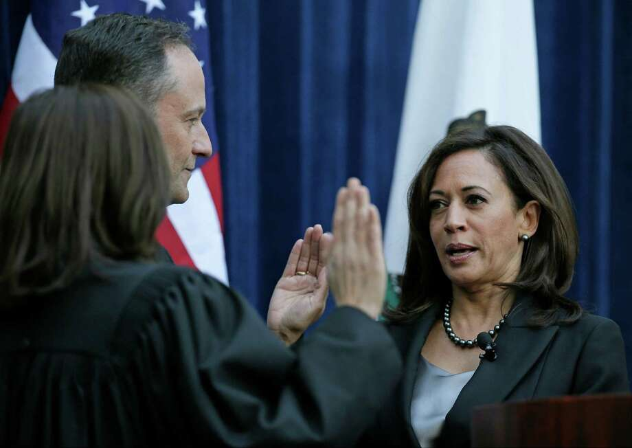 California Attorney General Kamala Harris, right, takes the oath of office last week from California Supreme Court Chief Justice Tani Cantil-Sakauye, left, as her husband, Douglas Emhoff, looks on at the Crocker Art Museum in Sacramento, Calif. Harris announced Tuesday that she will seek the U.S. Senate seat being vacated by Sen. Barbara Boxer. Photo: Eric Risberg / Eric Risberg / Associated Press / AP