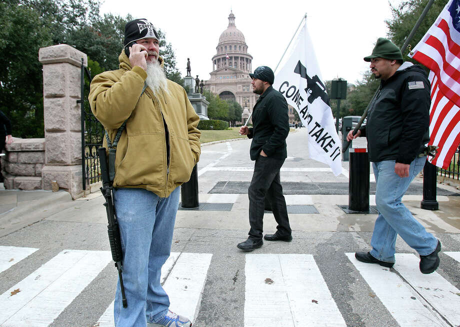 Phil Neumann, from Dallas, takes a cell phone call while demonstrating with others  in support of HB 195 before the in opening of the 2015 Legislature at the State Capitol on January 13, 2015. Photo: Tom Reel, San Antonio Express-News
