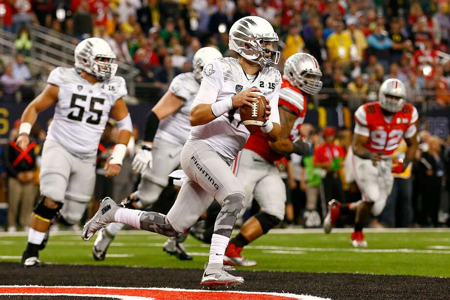 ARLINGTON, TX - JANUARY 12:  Quarterback Jeff Lockie #17 of the Oregon Ducks looks to pass out of his endzone in the fourth quarter against the Ohio State Buckeyes during the College Football Playoff National Championship Game at AT&T Stadium on January 12, 2015 in Arlington, Texas.  (Photo by Tom Pennington/Getty Images) Photo: Tom Pennington, Getty Images