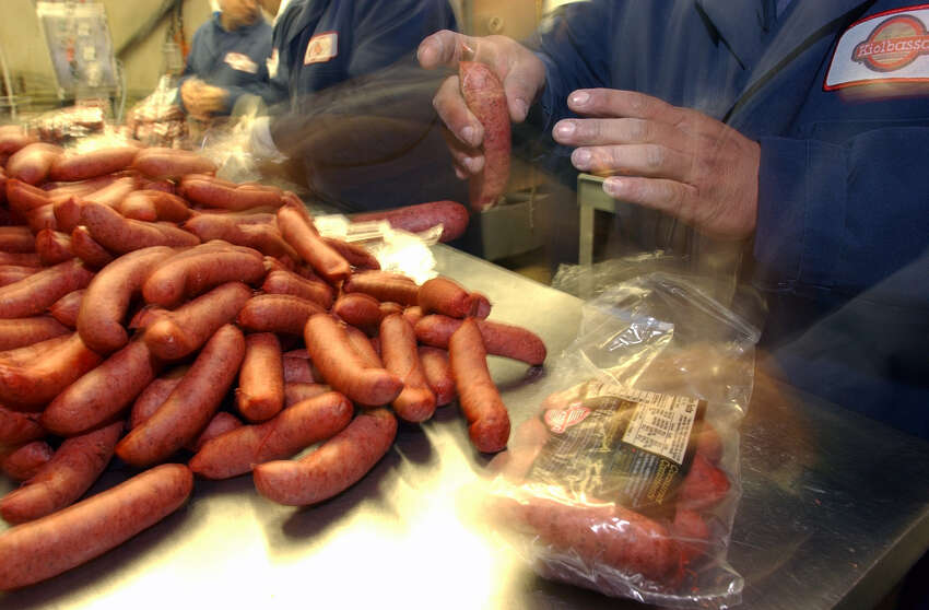 Workers at Kiolbassa Provision Co. work speedily to package their sausage product at the near West Side plant. JOHN DAVENPORT / STAFF