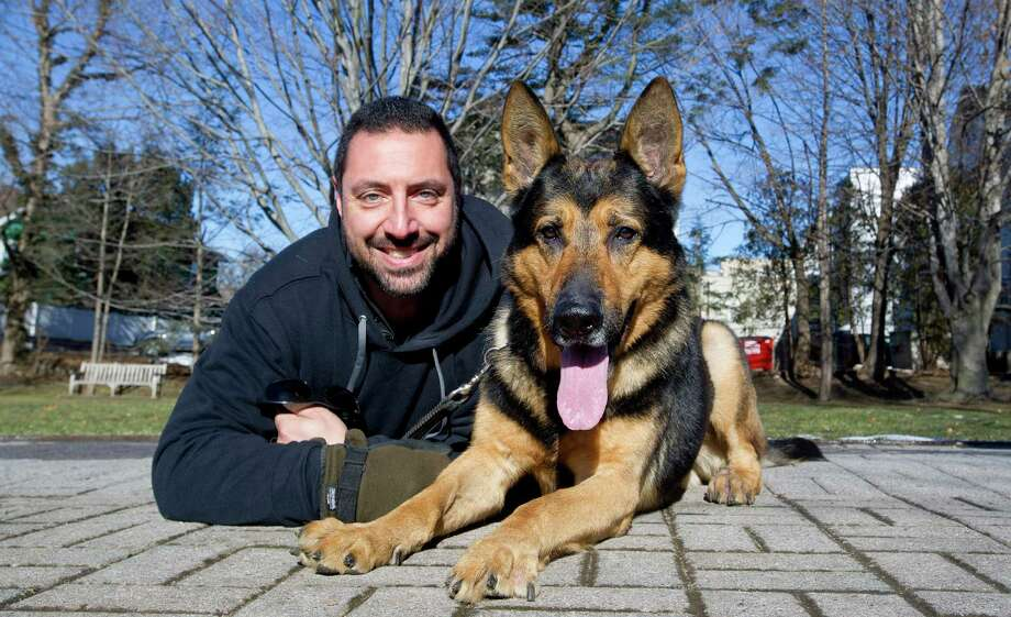 Greenwich Police Officer Michael Macchia poses for a photo with his retired partner, K-9 Tyro, in Greenwich, Conn., on Tuesday, January 13, 2015. Photo: Lindsay Perry / Stamford Advocate