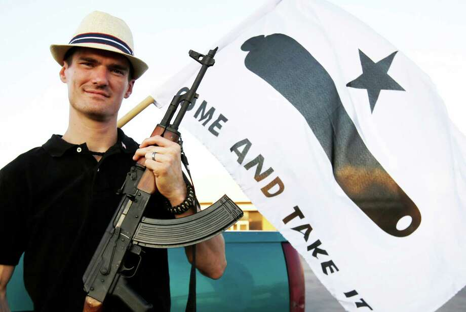 Kory Watkins, coordinator for Open Carry Tarrant County poses for a portrait holding his Romanian AK 47, Thursday, May 29, 2014, in Haltom City, Texas.  North Texas gun rights advocates are suing the city of Arlington for amending an ordinance that they claim is discriminatory and infringes upon free speech rights, in the latest sign of growing tensions among gun activists and government forces in Texas. (AP Photo/Tony Gutierrez) Photo: Tony Gutierrez, Associated Press / AP