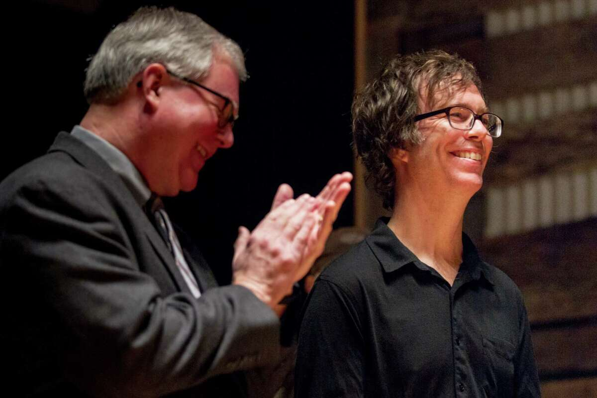 Ben Folds (right) is applauded Monday, Jan. 12, for his work to save Studio A on Nashville's Music Row.