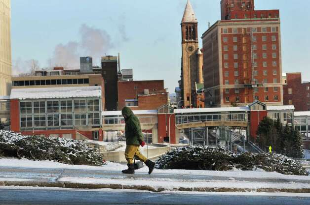 A man makes his way in the cold up Madison Avenue on Tuesday, Jan. 13, 2015, in Albany, N.Y.  (Paul Buckowski / Times Union) Photo: Paul Buckowski / 00030180A