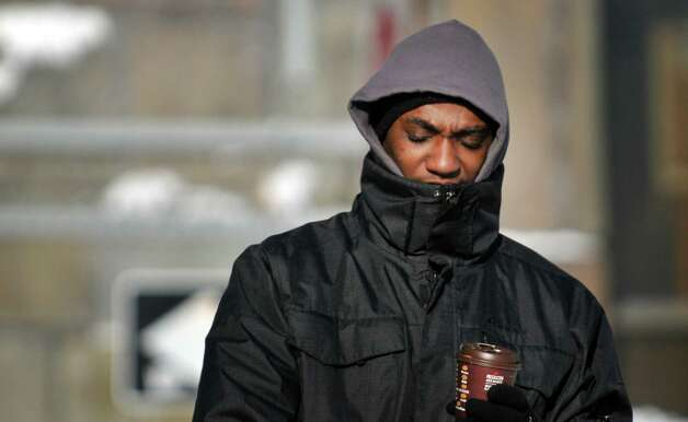 Marvin Stubbs of Albany walks into a cold wind as he makes his way through downtown on Tuesday, Jan. 13, 2015, in Albany, N.Y.  (Paul Buckowski / Times Union) Photo: Paul Buckowski / 00030180A