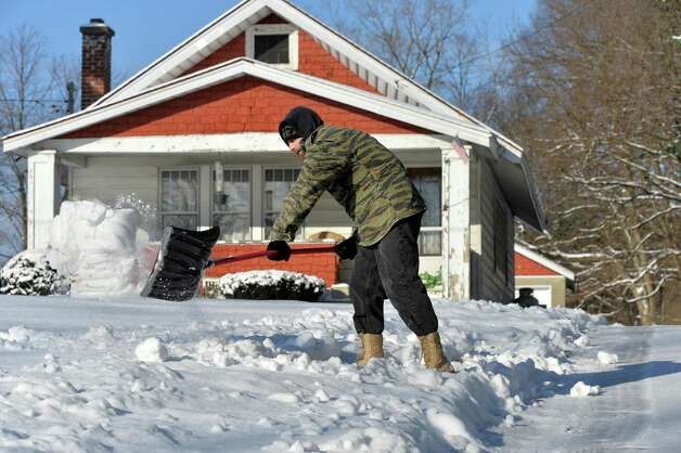 Cody Nagnier spends a bitter cold morning shoveling snow at his home Tuesday Jan. 13, 2015, in Schenectady, NY.   (John Carl D'Annibale / Times Union) Photo: John Carl D'Annibale / 00030180A