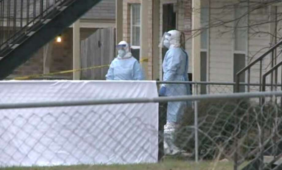 Screen capture of video from KWTX shows a hazmat team at the scene where a Fort Hood soldier was found dead outside his apartment. Photo: Courtesy Of KWTX