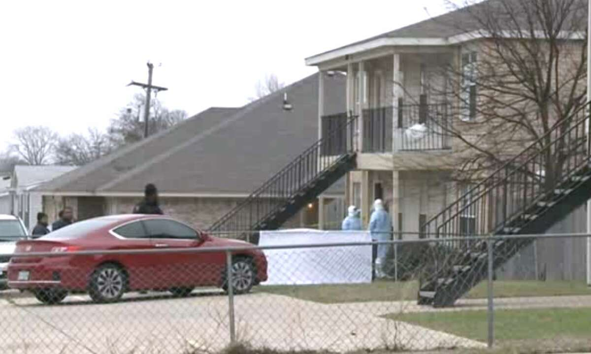 Screen capture of video from KWTX shows a hazmat team at the scene where a Fort Hood soldier was found dead outside his apartment.