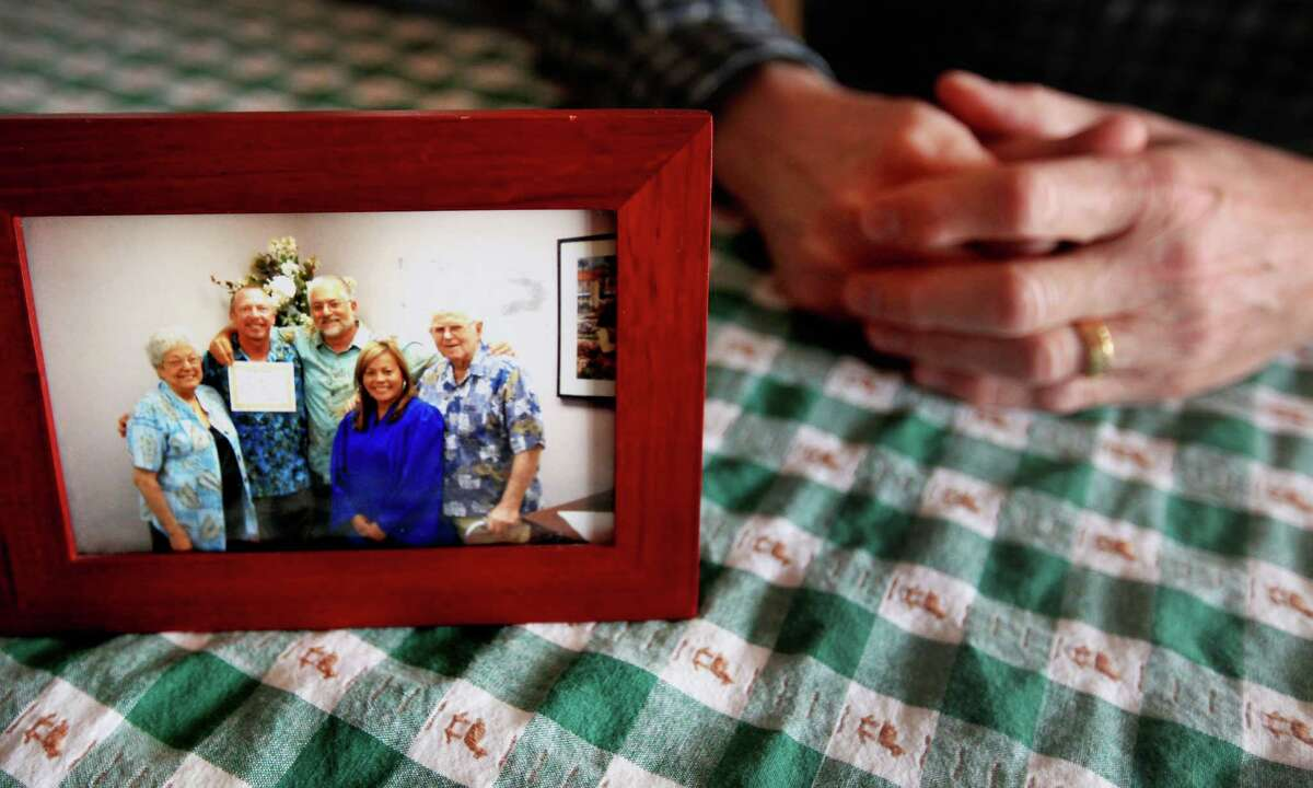 At his home in Fort Worth, Steven Rains displays a picture from his 2008 wedding to Don Condit in California. Texas denied Rains spousal benefits after Condit died.