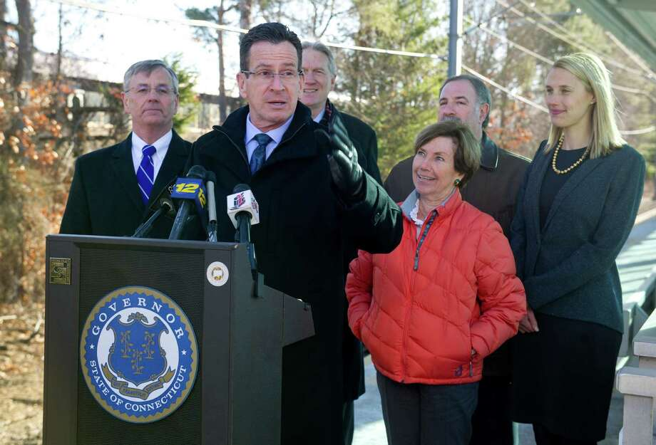 Governor Dannel Malloy speaks during a press conference at the Springdale train station in Stamford, Conn., on Tuesday, January 13, 2015, to announce improved service on the New Canaan branch of the Metro-North New Canaan line. Photo: Lindsay Perry / Stamford Advocate