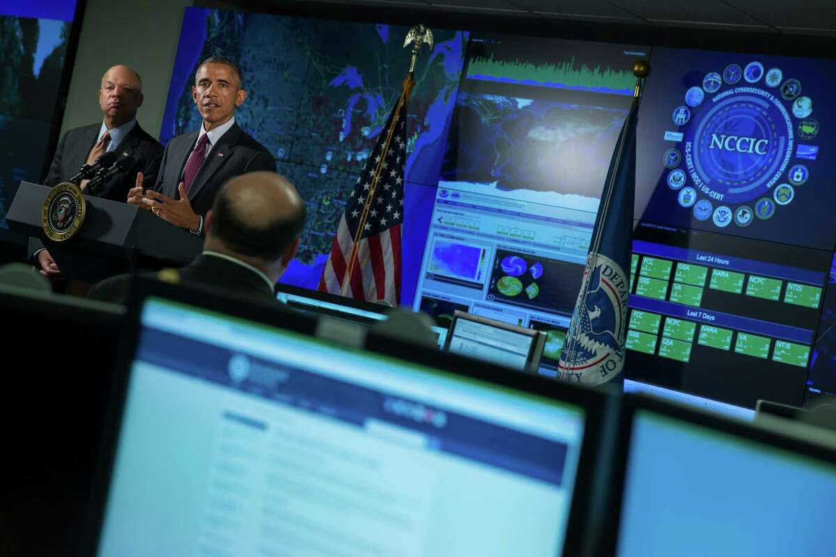Homeland Security Secretary Jeh Johnson listens as President Obama speaks at the National Cybersecurity and Communications Integration Center.