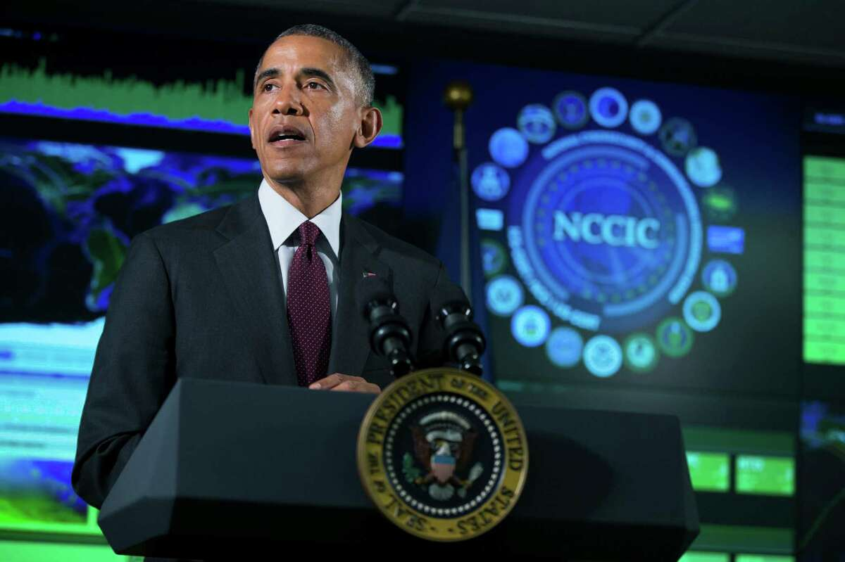 President Barack Obama speaks at the National Cybersecurity and Communications Integration Center in Arlington, Va.,Tuesday, Jan. 13, 2015. Obama renewed his call for Congress to pass cybersecurity legislation, including a proposal that encourages companies to share threat information with the government and protects them from potential lawsuits if they do. (AP Photo/Evan Vucci)