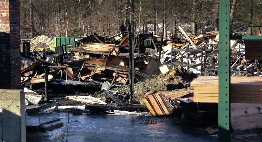 A large part of the NorthEast Building Supply lumber yard in Corwall, Conn., has been destroyed, by fire late Monday night, January 12, 2015. Photo: Skylar Magnoli / The News-Times