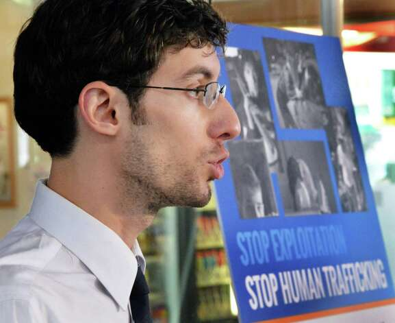 Human Trafficking Specialist Gonzalo Martinez de Vedia of the Worker Justice Center of New York speaks during a news conference to debut a poster to raise public awareness and bring attention to the scourge of human trafficking in New York on Tuesday Jan. 13, 2015, in Schenectady, NY.  (John Carl D'Annibale / Times Union) Photo: John Carl D'Annibale / 00030173A