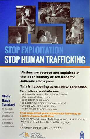 A new poster at the Guilderland rest stop of the state Thruway to raise public awareness and bring attention to human trafficking in NY Tuesday Jan. 13, 2015, in Schenectady, NY.  (John Carl D'Annibale / Times Union) Photo: John Carl D'Annibale / 00030173A