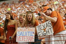 1. University of Texas - 425 AUSTIN, TX - NOVEMBER 07: Texas Longhorn fans cheer before a game against the UCF Knights on November 7, 2009 at Darrell K Royal - Texas Memorial Stadium in Austin, Texas. Texas won 35-3.