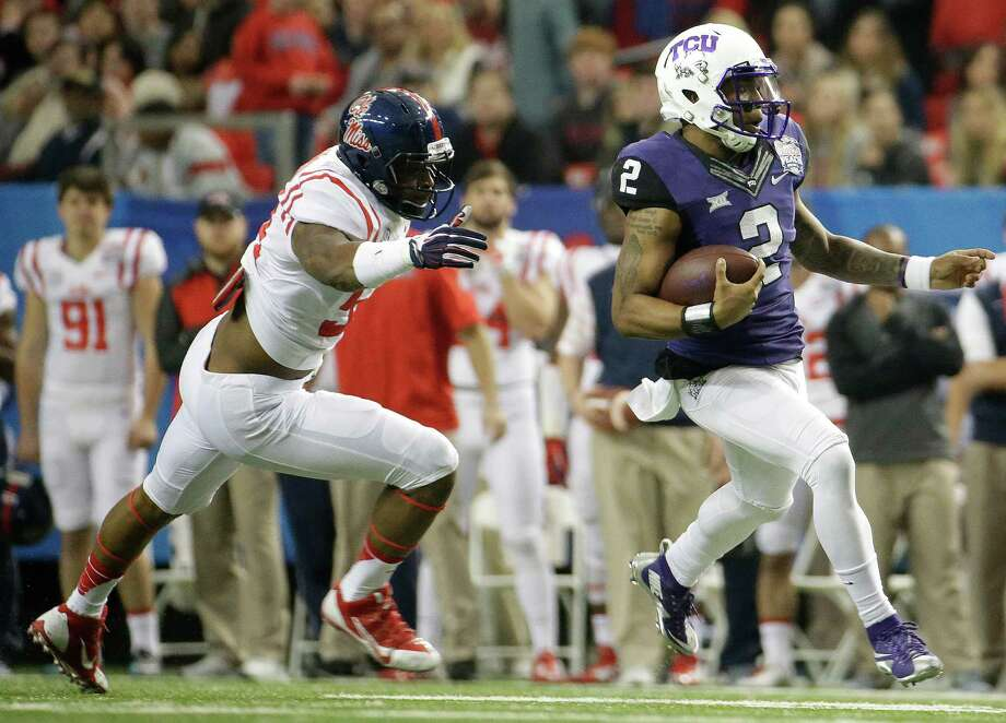 TCU quarterback Trevone Boykin runs past Mississippi defensive end Carlos Thompson during the first half of the Peach Bowl on Dec. 31, 2014, in Atlanta. Photo: David Goldman /Associated Press / AP