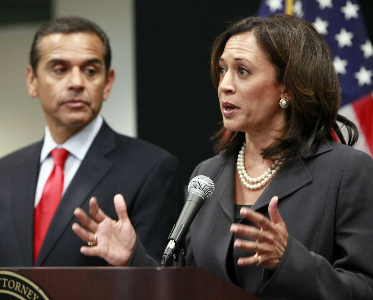 Attorney General Kamala Harris , right with Los Angeles Mayor Antonio Villaraigosa, speaks at a news conference regarding criminal and civil responses to mortgage fraud in Los Angeles Monday, May 23, 2011.
