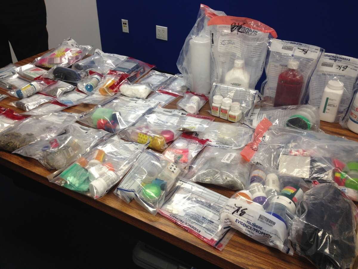 2. The price for heroin in the Houston region dropped from $1,200 per ounce in 2012 to $800 per ounce in 2013. This photo shows drugs and paraphernalia seized after a package containing heroin and other drugs was delivered to the wrong Houston-area address and the resident notified authorities, Wednesday, Oct. 15, 2014 in Houston. (AP Photo/Houston Chronicle, Craig Hlavaty)