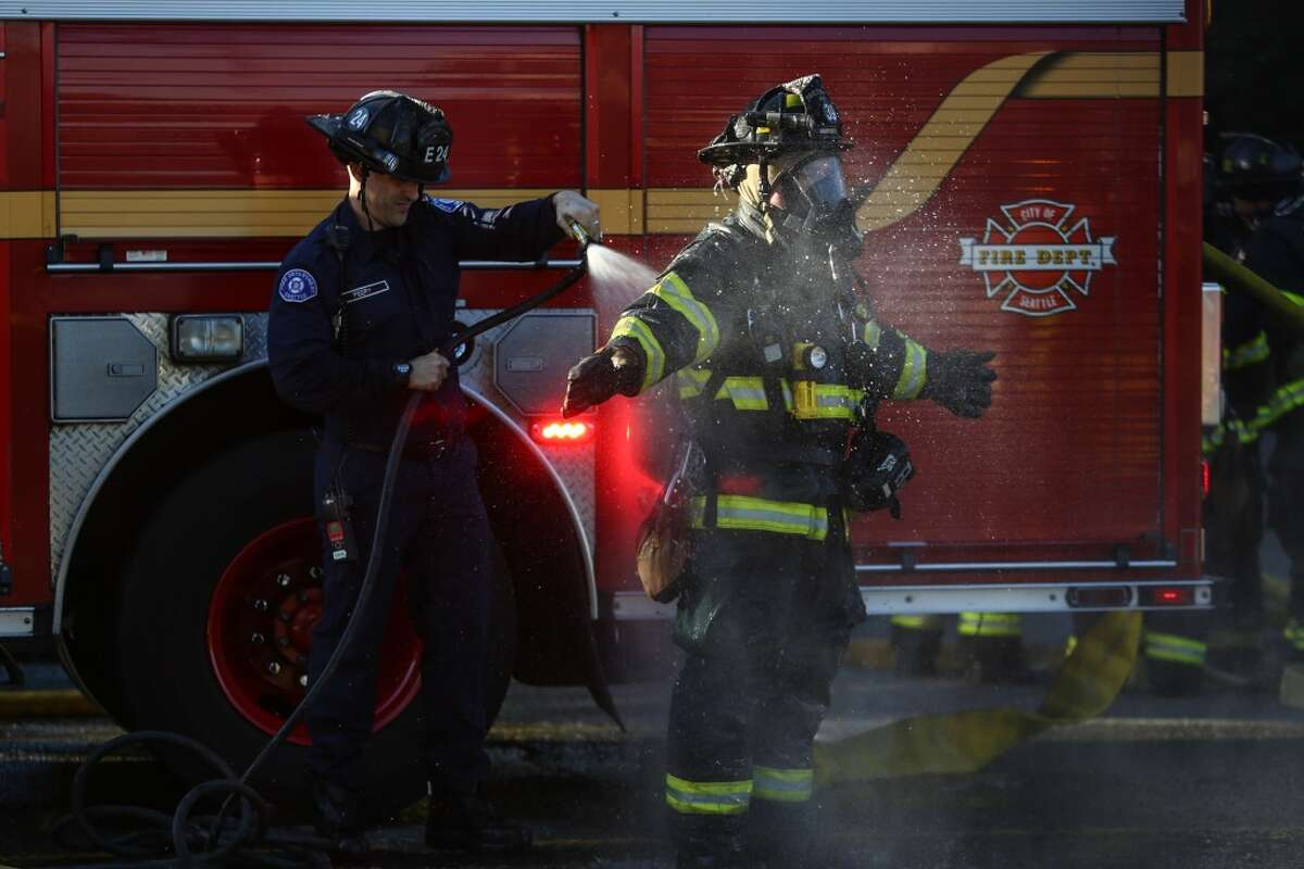 Seattle firefighters found flames coming from two stories of a four-story condo building in Northgate Tuesday afternoon. Crews knocked down the flames and no one was injured.