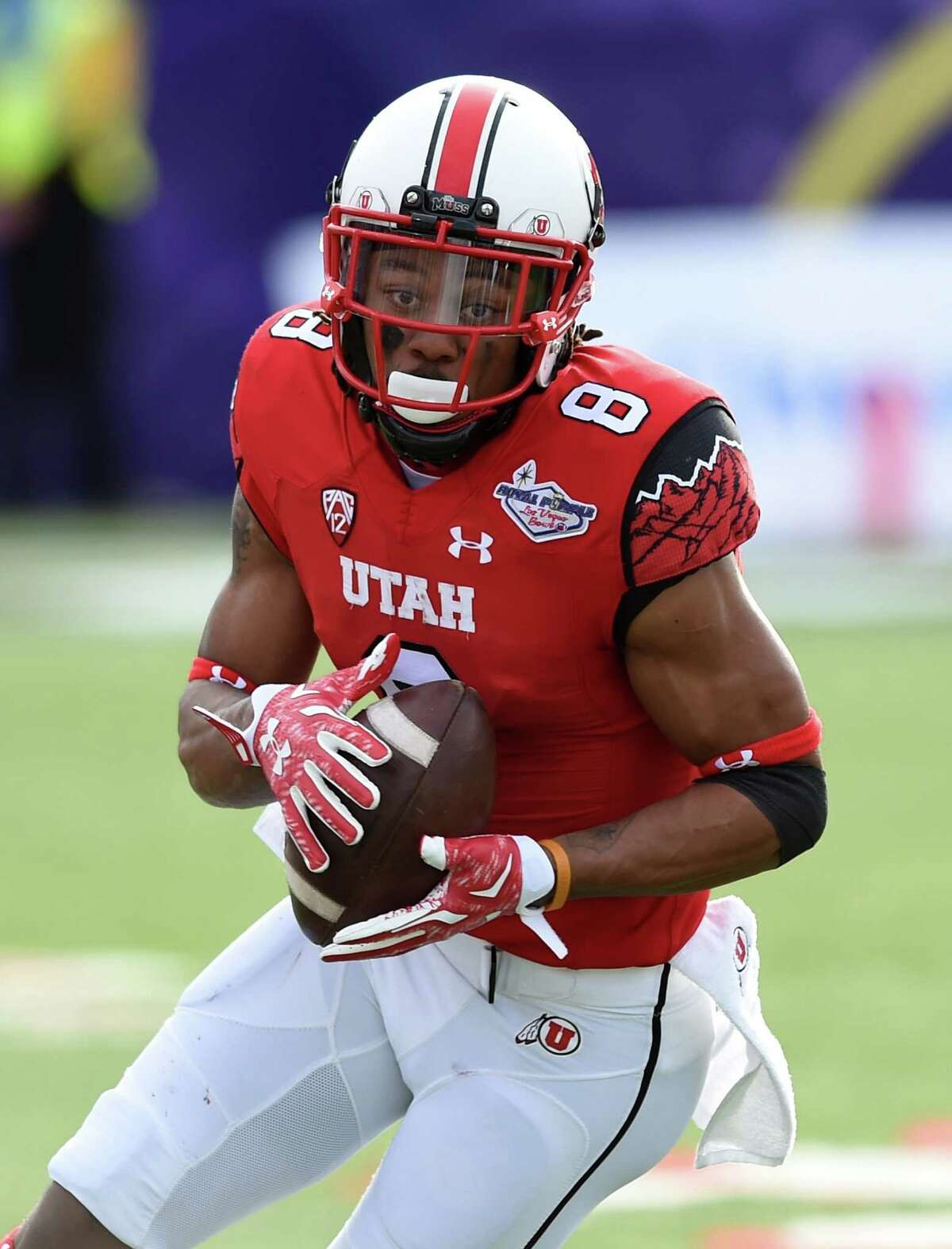LAS VEGAS, NV - DECEMBER 20: Wide receiver Kaelin Clay #8 of the Utah Utes runs for yardage after catching a pass against the Colorado State Rams during the Royal Purple Las Vegas Bowl at Sam Boyd Stadium on December 20, 2014 in Las Vegas, Nevada. Utah won 45-10. (Photo by Ethan Miller/Getty Images)