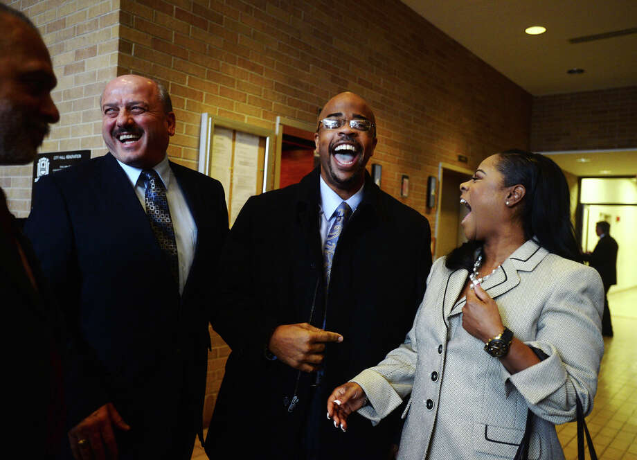 Dr. Joseph G. Majdalani, public works director, Jamie Smith, Jefferson County District Clerk, and Melanie Smith, left to right, share a laugh during a reception for William R. Sam, Sr., on Tuesday. Sam was sworn in as Ward IV councilman during the Beaumont City Council's normal meeting Tuesday afternoon. He is replacing Jamie Smith, who successfully ran for Jefferson County District Clerk, and will serve through the May election. Photo taken Tuesday 1/13/15 Jake Daniels/The Enterprise Photo: Jake Daniels / ©2014 The Beaumont Enterprise/Jake Daniels
