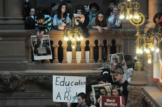 Students hold signs as they gather on the Million Dollar Staircase inside the Capitol for an education rally on Monday, Jan. 12, 2015, in Albany, N.Y.  The rally was organized by The Alliance for Quality Education, Citizen Action of New York, Make the Road New York, New York Communities for Change, New York State NAACP, New York State United Teachers, Strong Economy for All Coalition, United Federation of Teachers, and the Working Families Party.  Rally attendees called on the Governor and legislators to address educational inequality and attacks on public education.   (Paul Buckowski / Times Union) Photo: Paul Buckowski, Albany Times Union / 00030137A