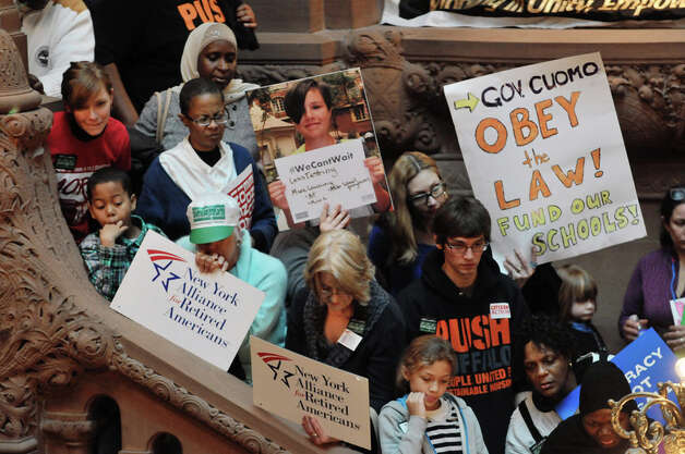 People gather on the Million Dollar Staircase inside the Capitol for an education rally on Monday, Jan. 12, 2015, in Albany, N.Y.  The rally was organized by The Alliance for Quality Education, Citizen Action of New York, Make the Road New York, New York Communities for Change, New York State NAACP, New York State United Teachers, Strong Economy for All Coalition, United Federation of Teachers, and the Working Families Party.  Rally attendees called on the Governor and legislators to address educational inequality and attacks on public education.   (Paul Buckowski / Times Union) Photo: Paul Buckowski, Albany Times Union / 00030137A