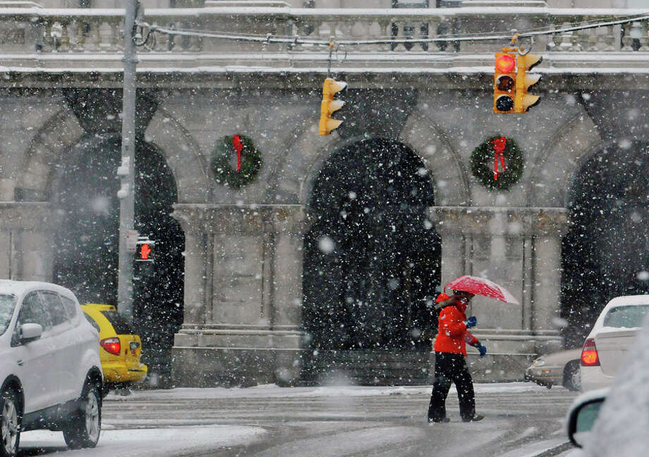 A woman trudges up Washington Ave. as snow blankets her in on Monday, Jan. 12, 2015, in Albany, N.Y.  (Paul Buckowski / Times Union) Photo: Paul Buckowski, Albany Times Union / 00030160A