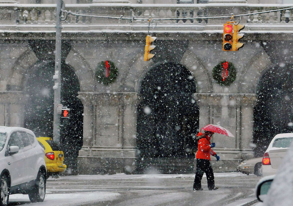 A woman trudges up Washington Ave. as snow blankets her in on Monday, Jan. 12, 2015, in Albany, N.Y. (Paul Buckowski / Times Union)