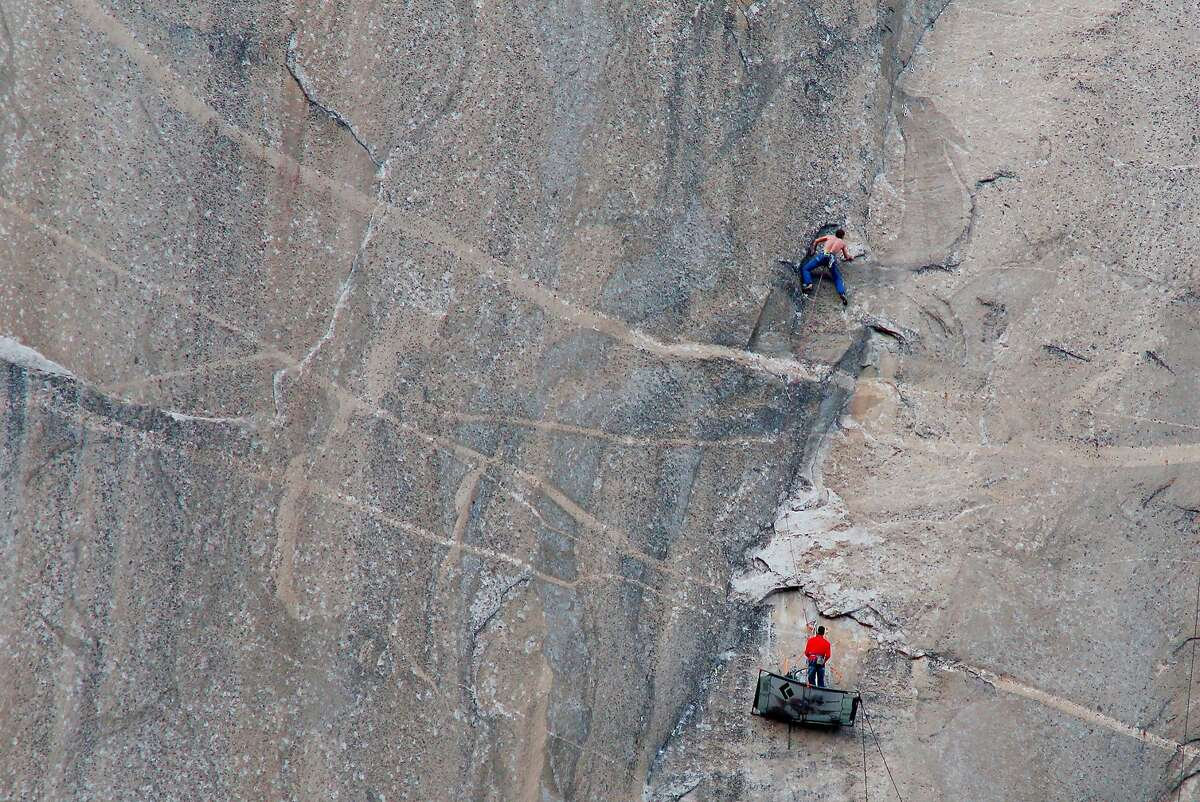 On Wednesday, January 7, 2015, Tommy Caldwell (shirtless) climbed Pitch 17 of the Dawn Wall on El Capitan in Yosemite. Kevin Jorgeson (in red) is belaying below.
