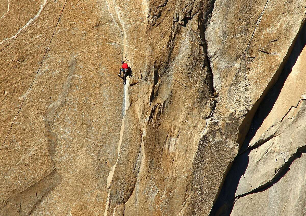 Kevin Jorgeson climbing Pitch 11 of the Dawn Wall of El Capitan in Yosemite National Park on Wednesday, December 31, 2014.