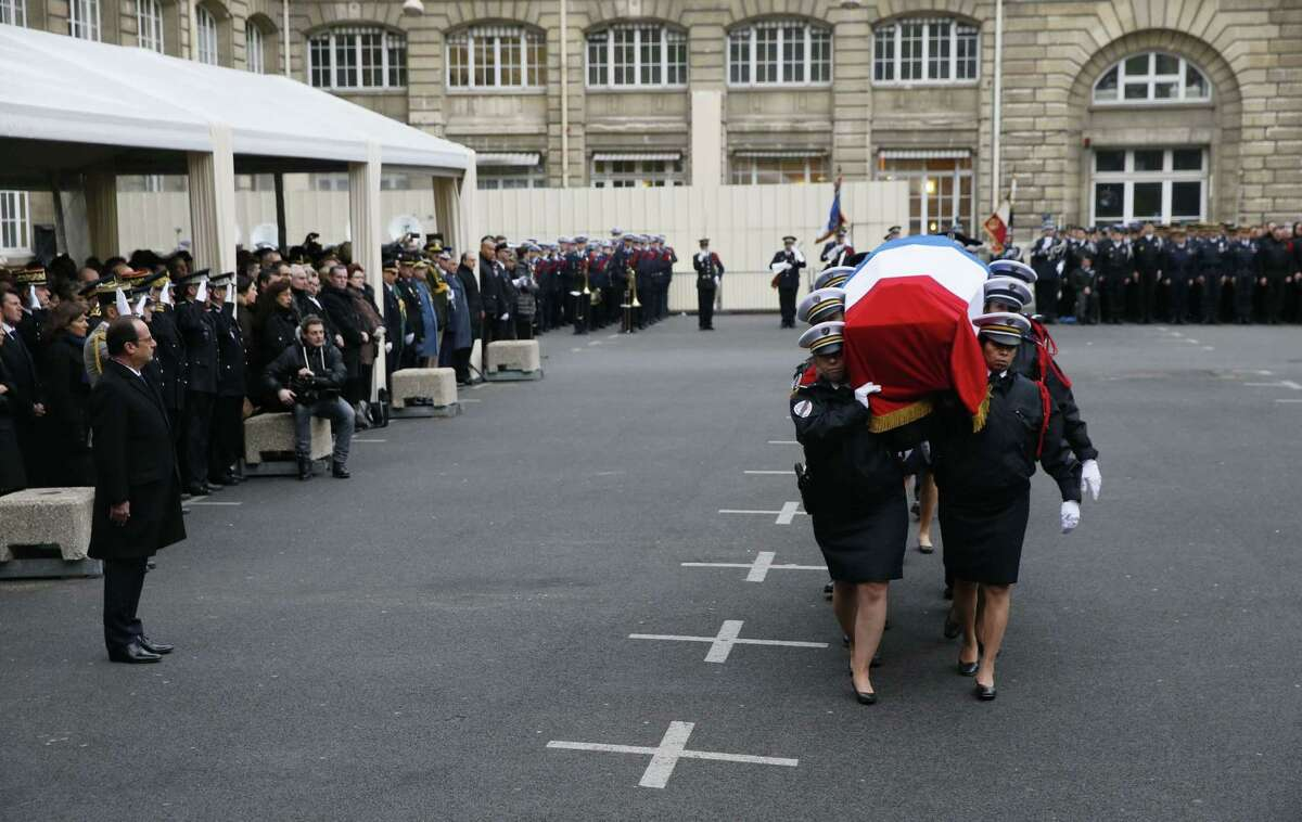 French president Francois Hollande pays tribute to the police officers killed in the recent terror attacks, during a ceremony in Paris.