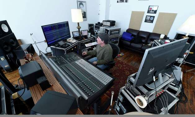 Recording engineer Mark Cochi shows off his audio engineering room at the Clock Tower building at 37 Prospect Street Wednesday afternoon, Jan. 7, 2015, in Amsterdam, N.Y. (Skip Dickstein/Times Union) Photo: SKIP DICKSTEIN / 00029904A