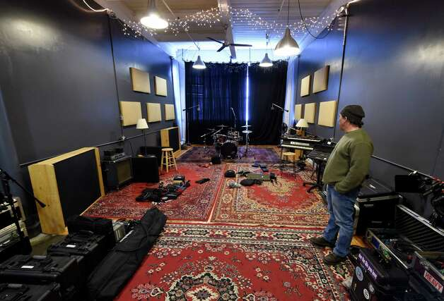 Recording engineer Mark Cochi shows off his recording studio at the Clock Tower building at 37 Prospect Street Wednesday afternoon, Jan. 7, 2015, in Amsterdam, N.Y. (Skip Dickstein/Times Union) Photo: SKIP DICKSTEIN / 00029904A