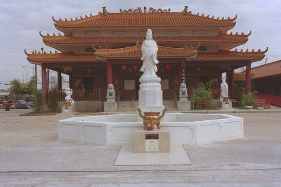 CONTACT FILED:  TEXAS GUANDI TEMPLE The Texas Guandi Temple is photographed on 01/15/01 for a Houston module that tells the story behind this opulent, authentic Buddhist temple and explores it from a cultural perspective.  Photograph by Betty Tichich.       HOUCHRON CAPTION (01/18/2001):  A statue of Quan Yin, the goddess of mercy and guardian of Earth, greets visitors at the gate of the Texas Guandi Temple.
