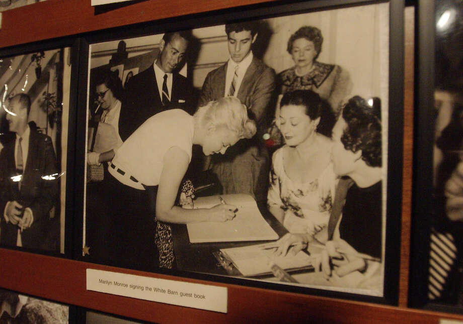 A New Canaan firm wants to develop a cluster of houses along the Westport-Norwalk line on a piece of property that was formerly the site of the legendary White Barn Theater. Among the stars who visited the White Barn, was Marilyn Monroe, seen here signing the theater's guestbook. Photo: Contributed Photo, ST / Greenwich Time Contributed