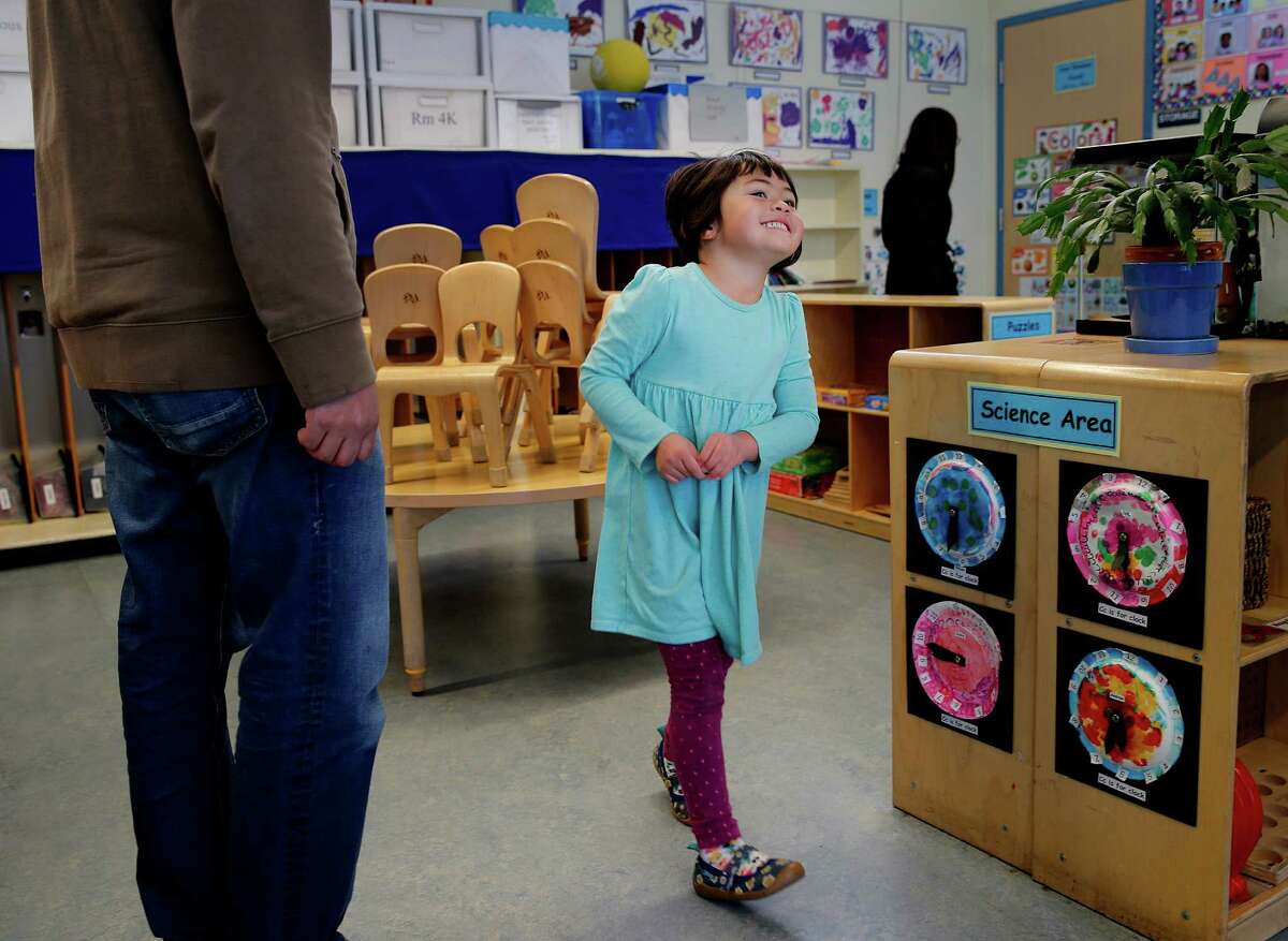 Four year old Parker Lan enjoyed showing her parents her classroom and art projects at the Noriega Child Development Center Tuesday January 13, 2015. San Francisco Mayor Ed Lee will announce an expansion of preschool for children in the city who will join classes like those at the Noriega Child Development Center.