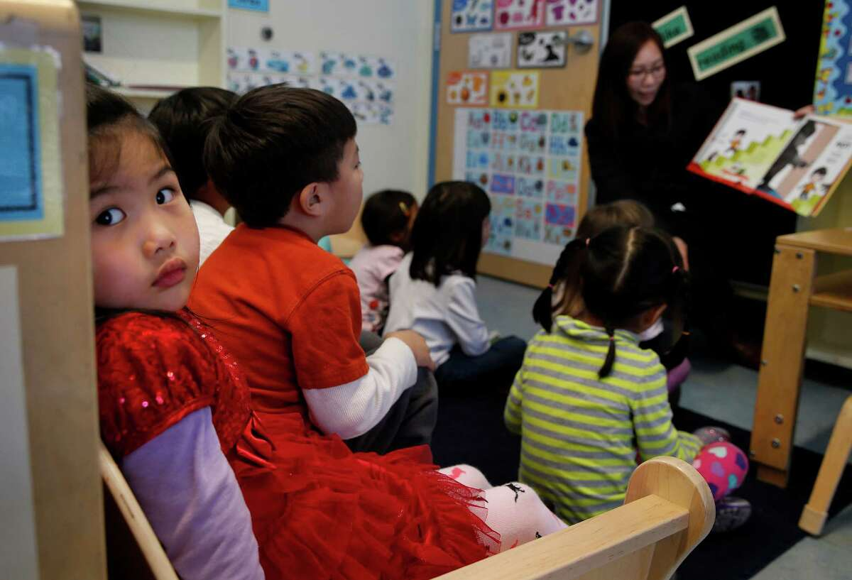 Four year old Kexin Lee was distracted as she attended her preschool class at the Noriega Child Development Center Tuesday January 13, 2015. San Francisco Mayor Ed Lee will announce an expansion of preschool for children in the city who will join classes like those at the Noriega Child Development Center.