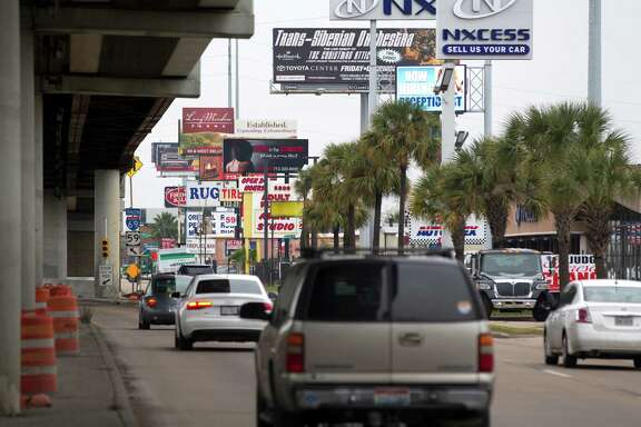 Billboards blot the sky Tuesday along the southbound Southwest Freeway near Fountain View. The City Council has billboard removal on its Wednesday agenda.