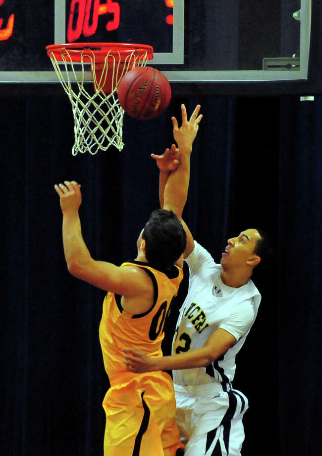 Notre Dame of Fairfield's Jordan Pettway fouls Weston's Zachary Spencer as he attempts a shot, during basketball action in Fairfield, Conn., on Tuesday Jan. 13, 2015. Photo: Christian Abraham / Connecticut Post