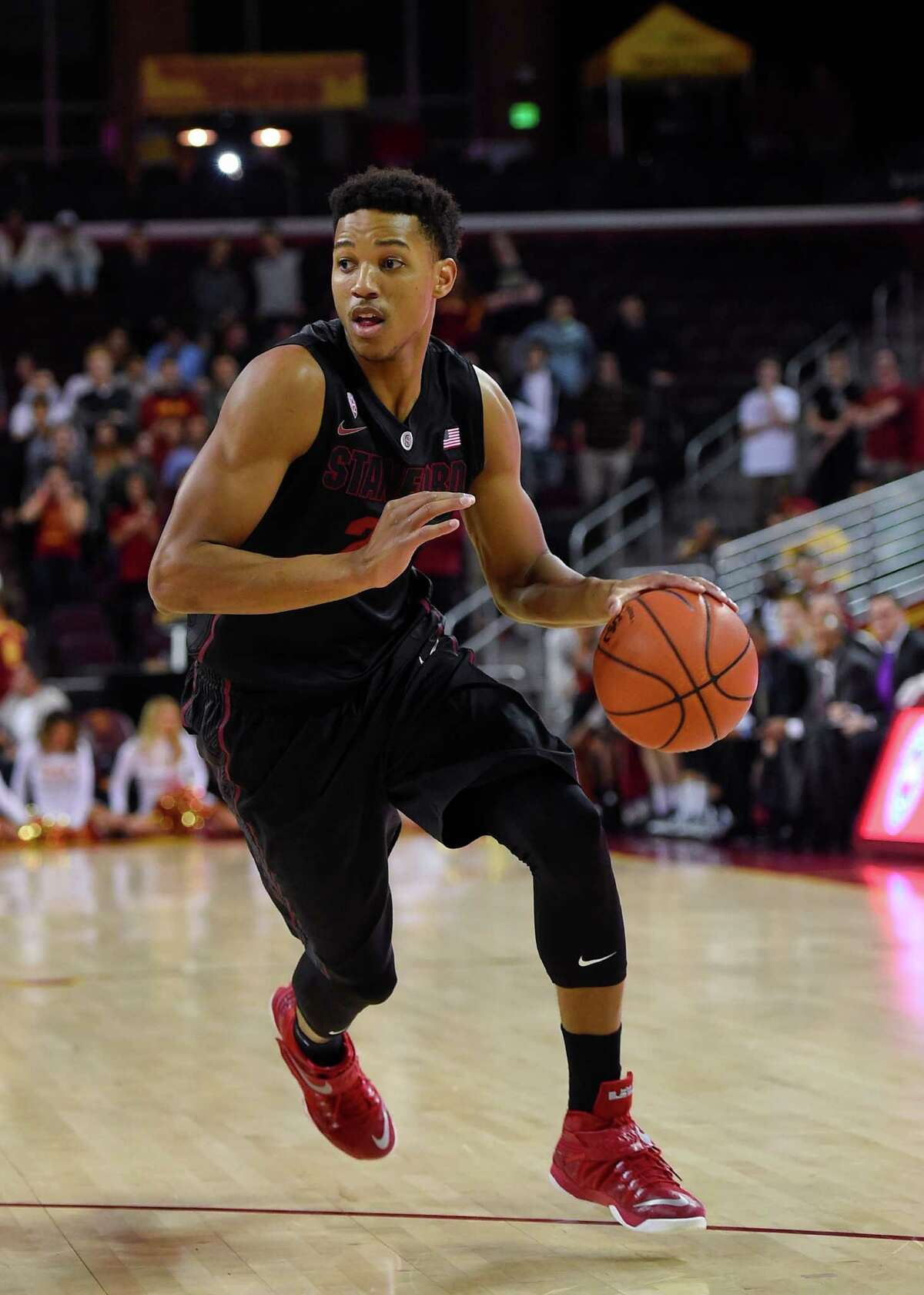 Stanford swingman Anthony Brown brings the ball up the court during the first half of an NCAA college basketball game against Southern California, Sunday, Jan. 11, 2015, in Los Angeles. (AP Photo/Gus Ruelas)