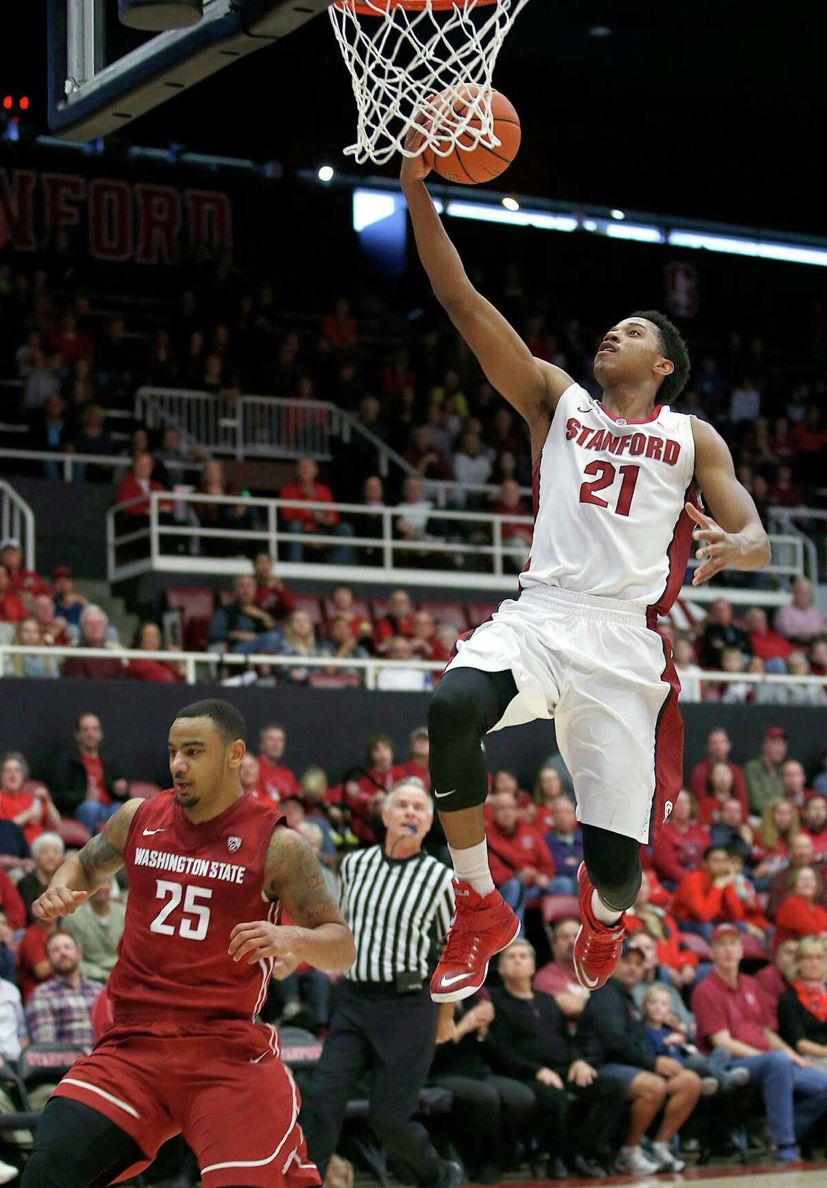 Stanford forward Anthony Brown (21) drives to the basket past Washington State guard DaVonte Lacy (25) during the second half of an NCAA college basketball game on Friday, Jan. 2, 2015, in Stanford, Calif. Stanford won 71-56. (AP Photo/Tony Avelar)