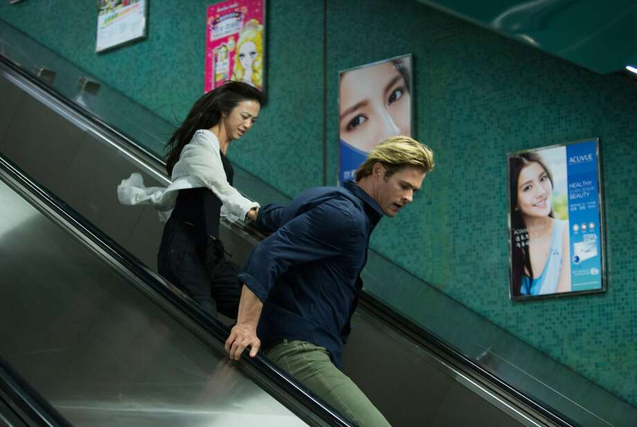 """This photo provided by Universal Pictures shows, Tang Wei, left,  as Chen Lien, and Chris Hemsworth, as Nicholas Hathaway in Legendary's film, """"Blackhat,"""" from director/producer Michael Mann.  (AP Photo/Legendary Pictures - Universal Pictures, Frank Connor) Photo: Frank Connor, Associated Press"""